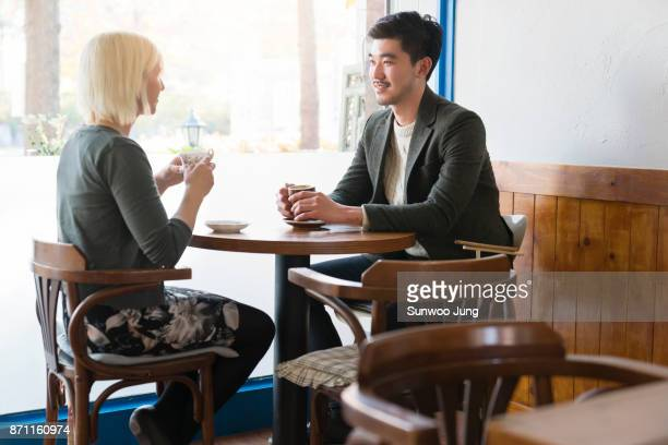 Couple drinking coffee at cafe table