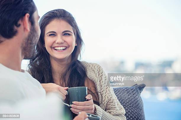 couple drinking coffee on the sofa. - real wife sharing stock photos and pictures
