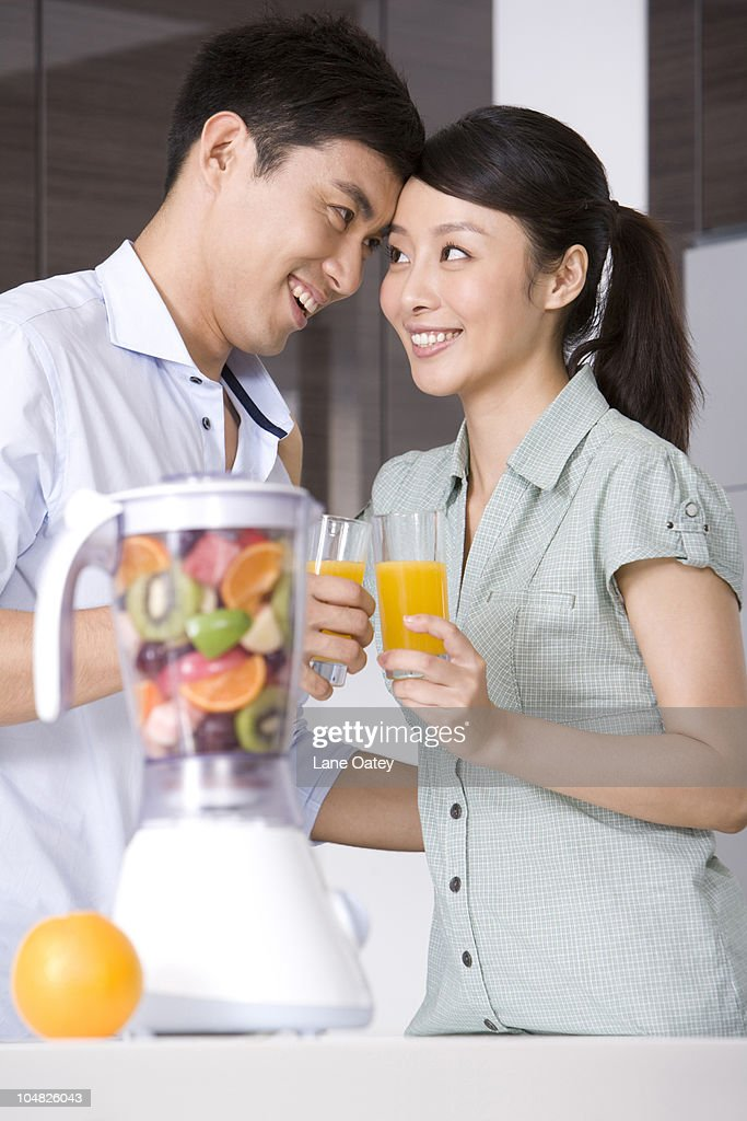 Couple drinking fresh fruit juice : Stock Photo