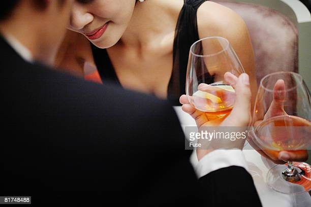 Couple Drinking Glasses of Cognac