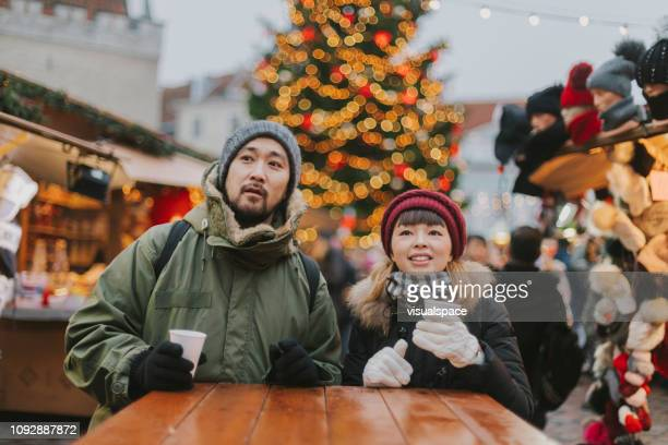 Couple drinking mulled wine at Christmas market