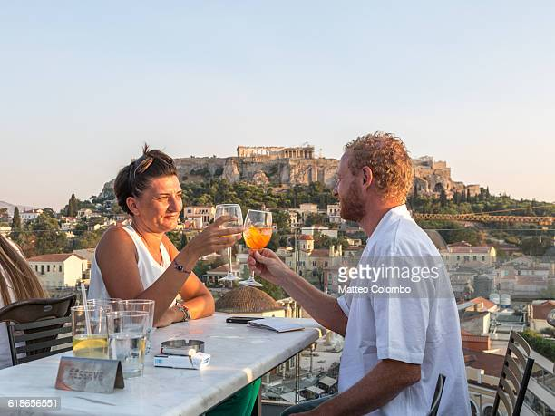 Couple drinking near the Acropolis. Athens, Greece