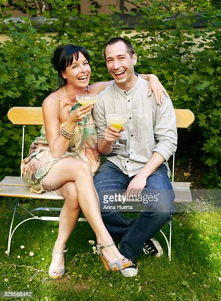 Couple drinking orange juice in backyard