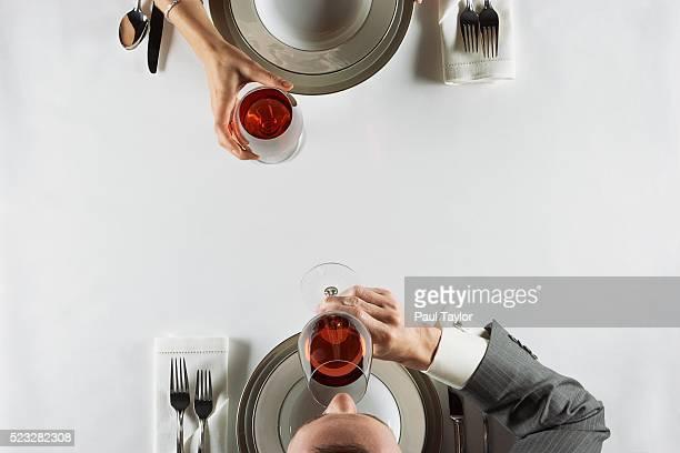 Couple drinking red wine in fine restaurant