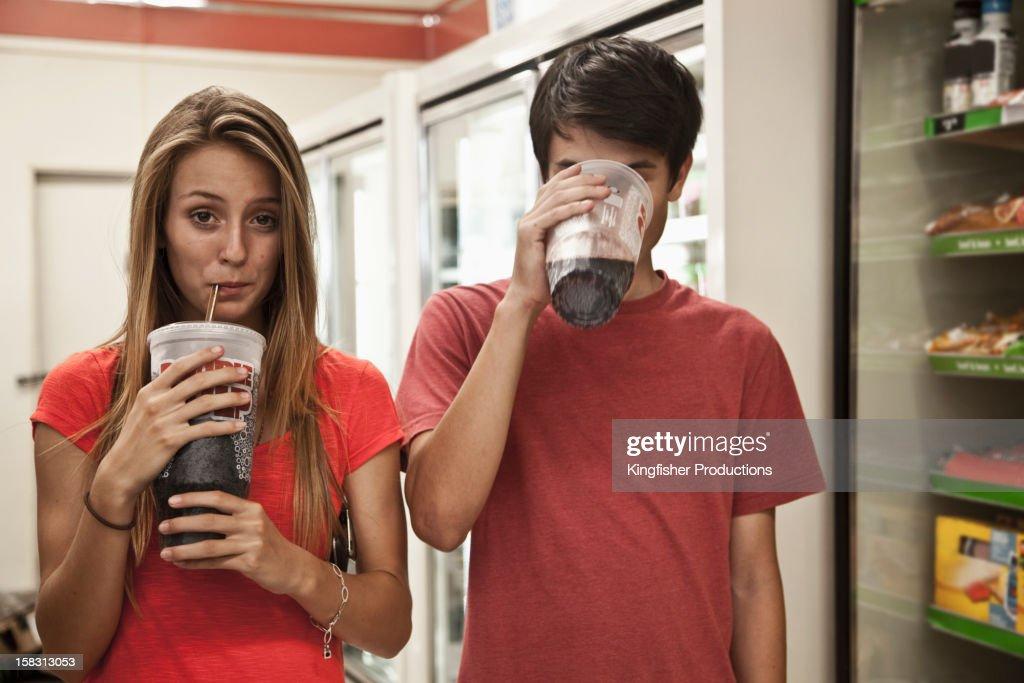 Couple drinking soda : Stock Photo