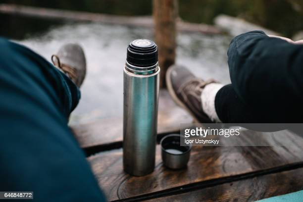couple drinking tea from thermos - flask stock pictures, royalty-free photos & images
