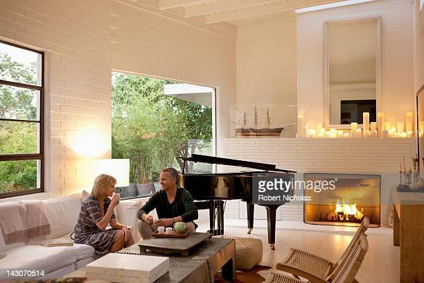 Couple drinking tea in modern living room