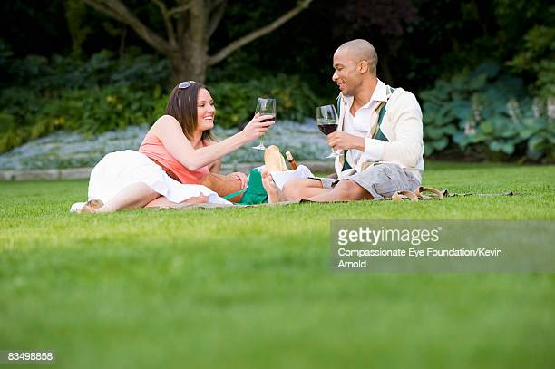 Couple drinking wine at a picnic