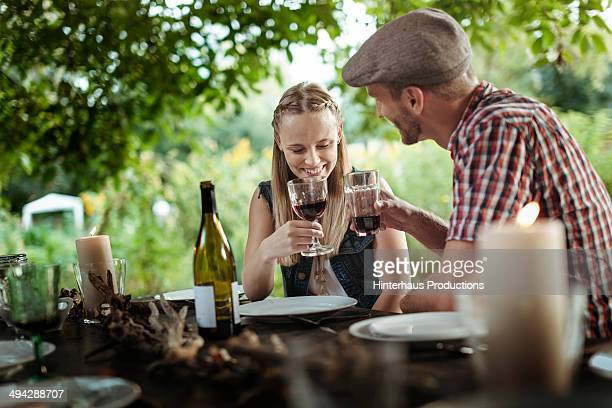 Couple Drinking Wine At Garden Party