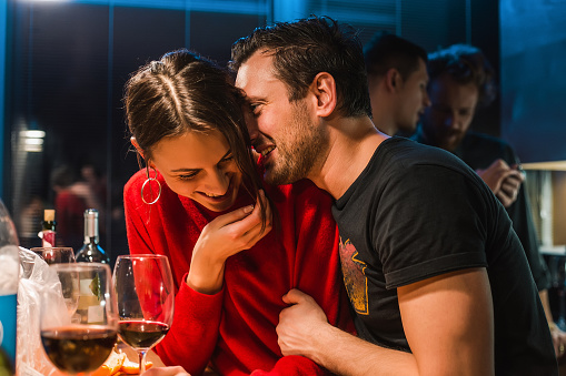 Couple drinking wine at party in apartment - gettyimageskorea