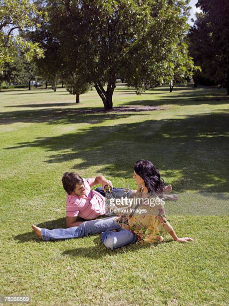 Couple drinking wine in a park.