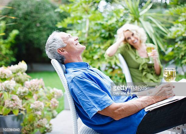 Couple drinking wine on patio