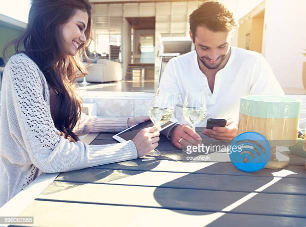 Couple drinking wine on the terrace.