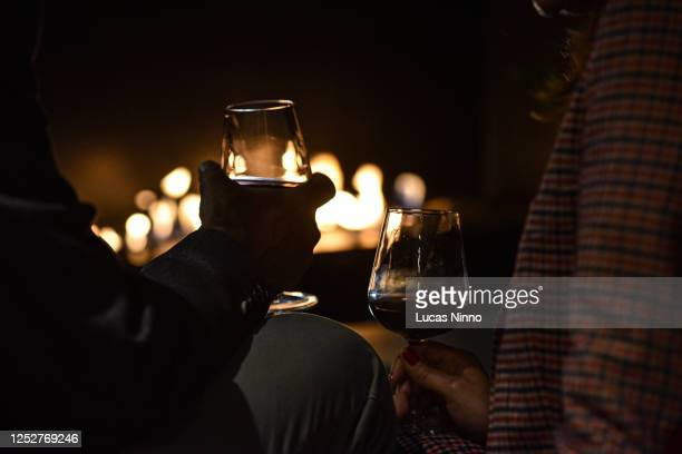couple drinking wine - celebratory toast stock pictures, royalty-free photos & images