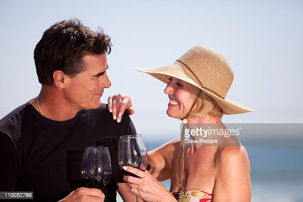 couple drinking wine together - 50 59 years stock pictures, royalty-free photos & images