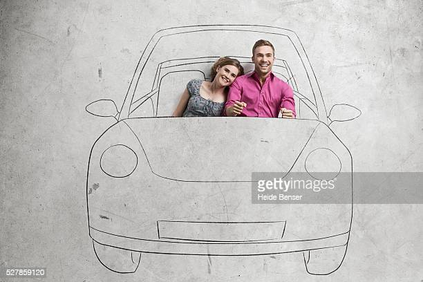 Couple driving drawing car