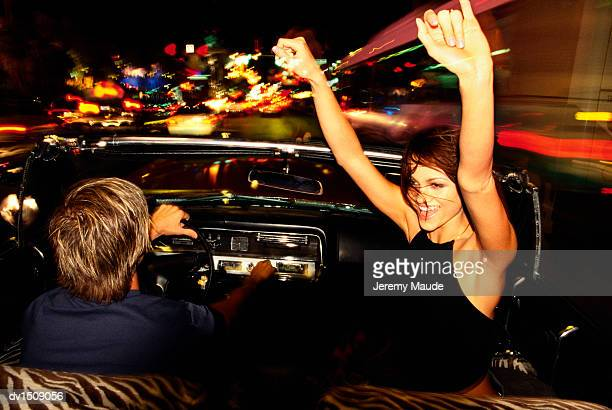 couple driving in a convertible car at night in las vegas, usa - ラスベガス ストックフォトと画像