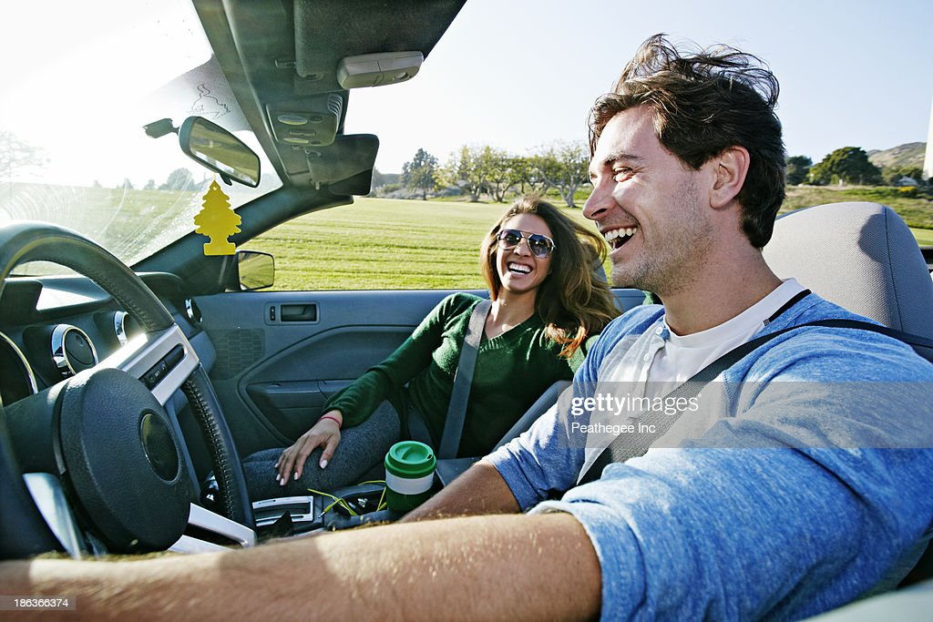 Couple driving in convertible : Stock Photo