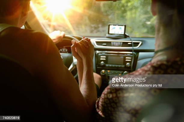 couple driving in sunny car - gps map stock photos and pictures