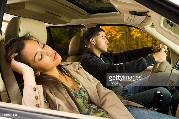 Couple driving on road trip