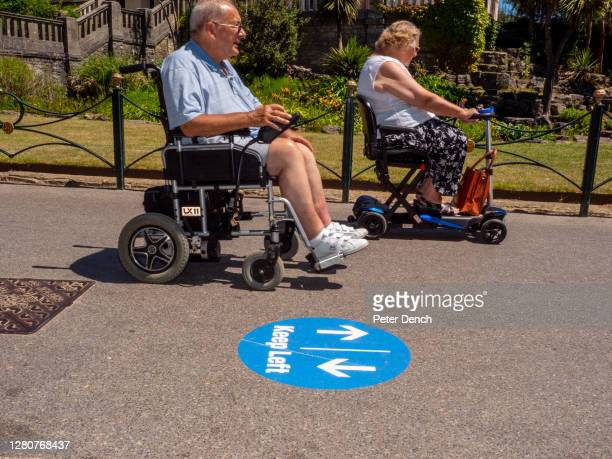 Couple driving their mobility scooters towards Bournemouth beach on June 25,2020 in Bournemouth, England. A major incident was declared after...