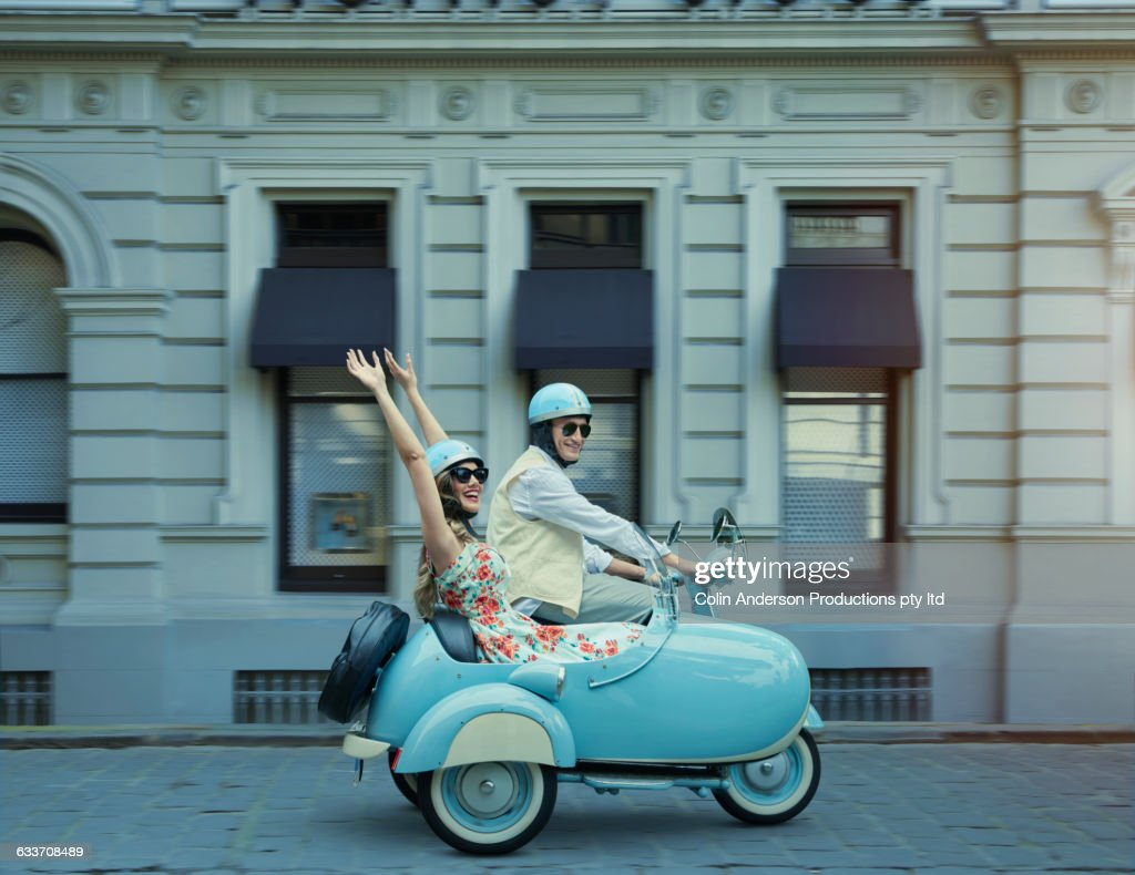 Couple Driving Vintage Scooter And Sidecar Stock Photo Getty Images