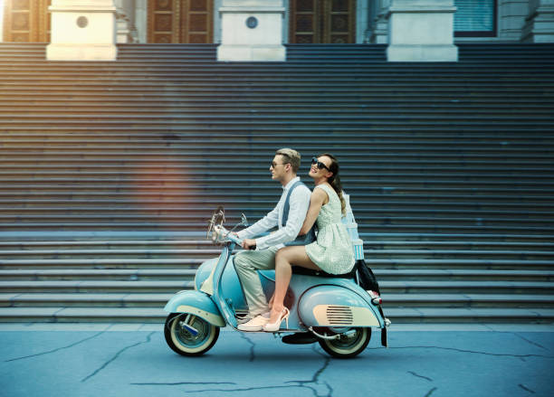couple driving vintage scooter - couples romance stock pictures, royalty-free photos & images