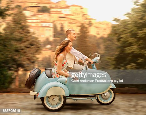 Couple Driving Vintage Scooter With Sidecar Stock Photo Getty Images