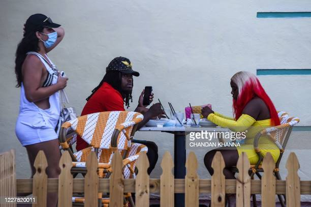 Couple eat dinner at a restaurant in Miami Beach, Florida on July 28 amid the coronavirus pandemic.