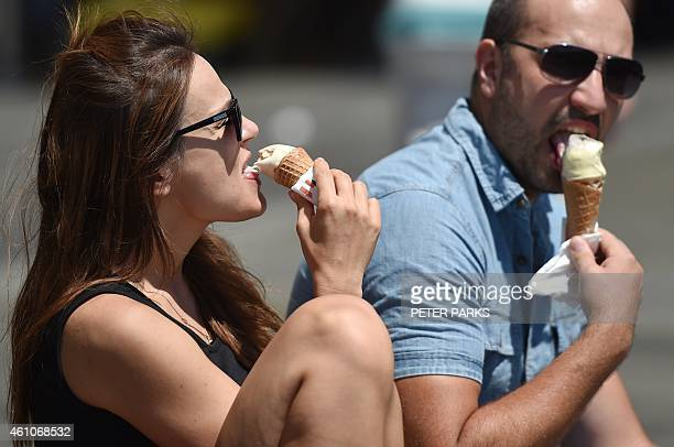 A couple eat ice cream to keep cool in the summer heat in Sydney on January 6 2015 Australia experienced its thirdhottest year on record in 2014...