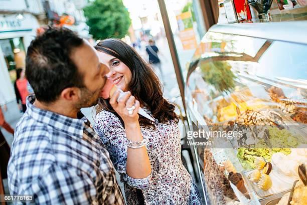 Couple eating an ice cream cone