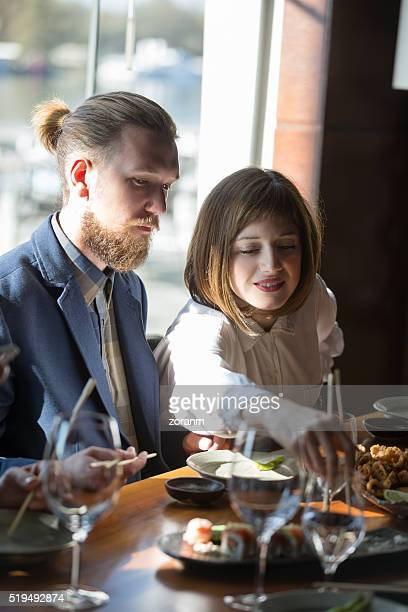 Couple eating asian food