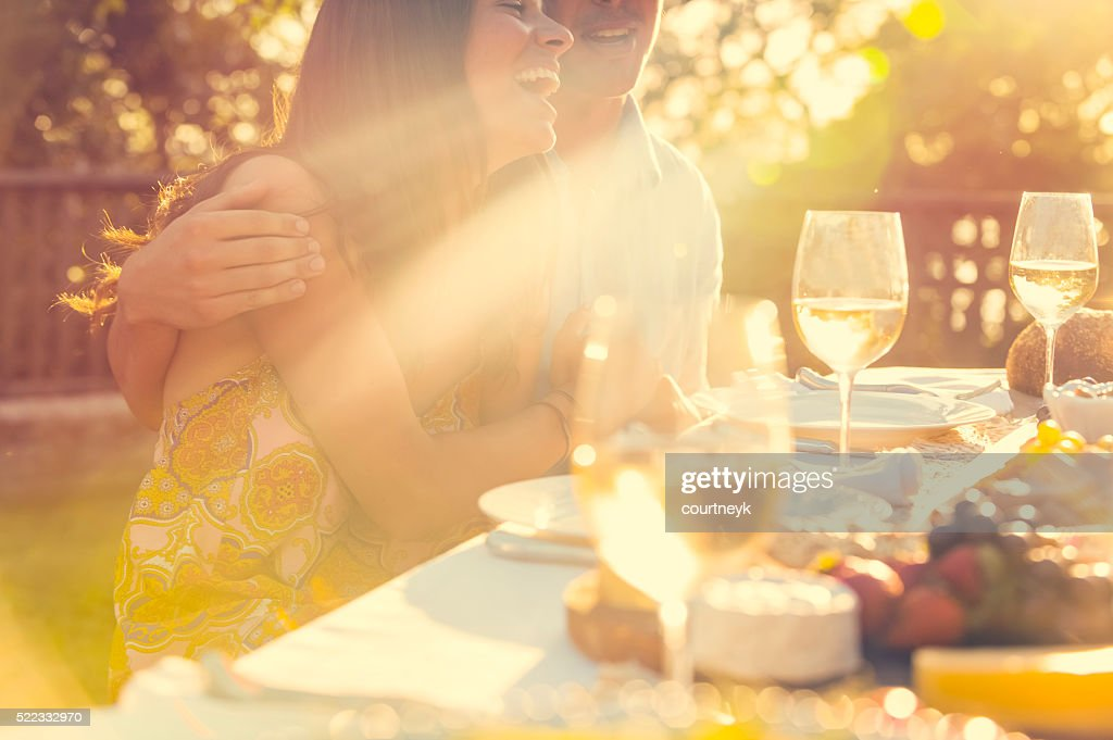 Couple eating at an outdoor restaurant with friends. : Stock Photo