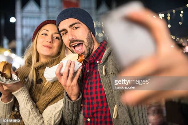 couple eating at the christmas market
