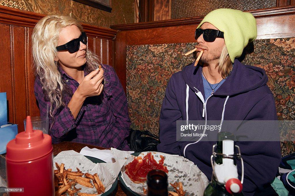 Couple eating bar food at a bar. : Stock Photo