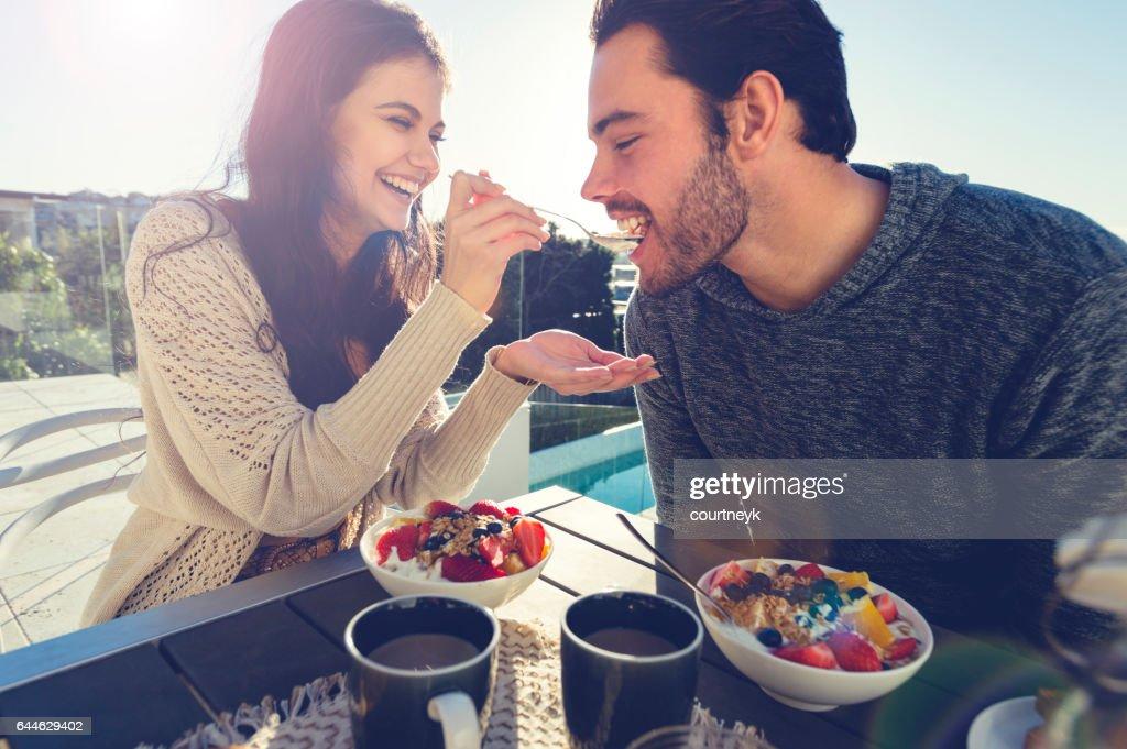 Couple eating breakfast outdoors. : Stock Photo