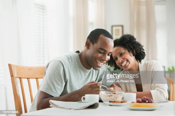 couple eating breakfast - man eating woman out stock photos and pictures
