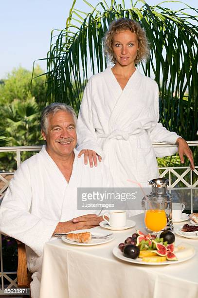Couple eating breakfast table on patio