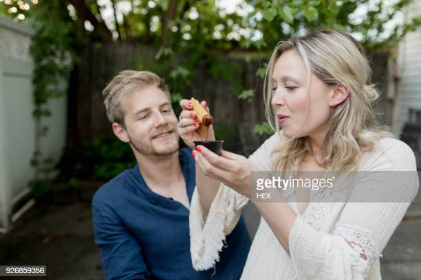 couple eating churros together - churro stock photos and pictures