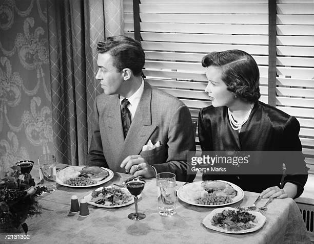 Couple eating dinner (B&W), elevated view