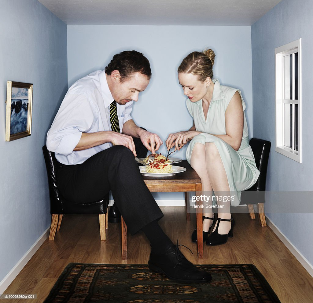 Couple eating dinner in small dining room : Photo
