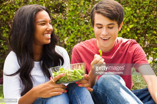 Couple eating edamame together