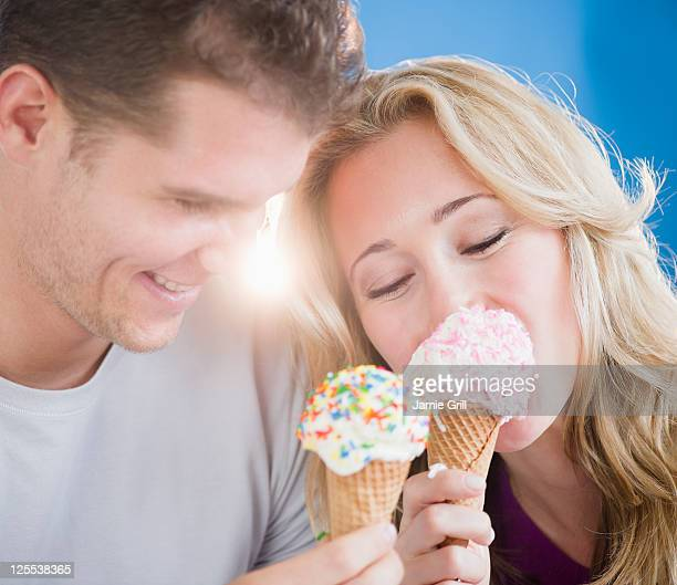 Couple eating ice cream cones together