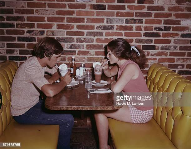Couple Eating Ice Cream In Restaurant