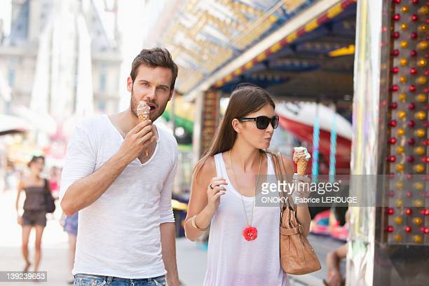 Couple eating ice creams, Paris, Ile-de-France, France