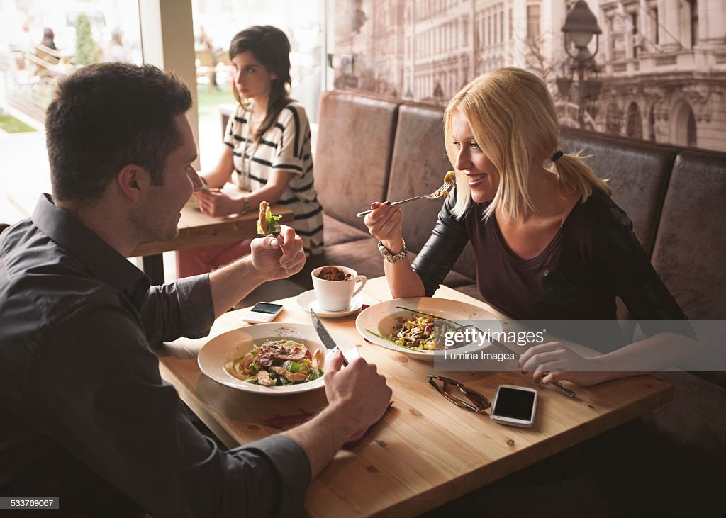 Couple eating in cafe : Stock Photo