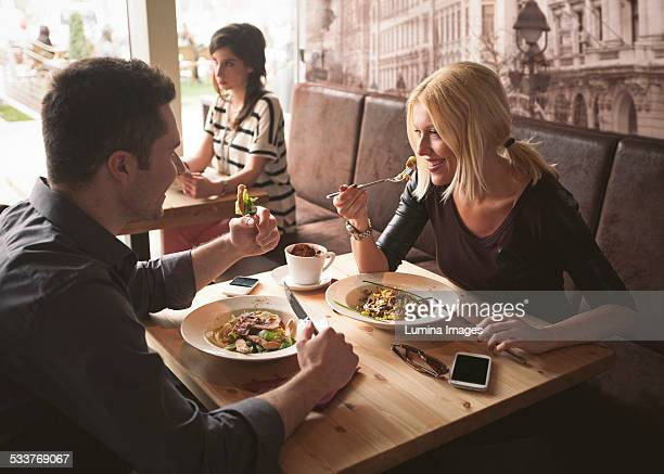couple eating in cafe - man eating woman out stock photos and pictures