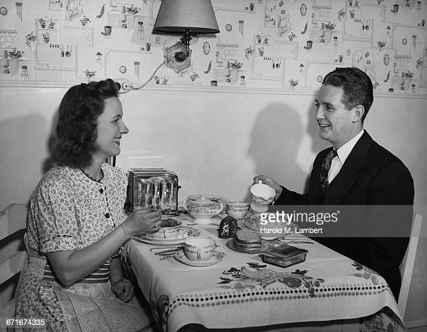 couple eating in room - number of people stock pictures, royalty-free photos & images
