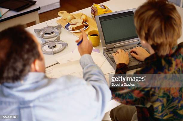 Couple Eating Lunch and Managing Their Finances