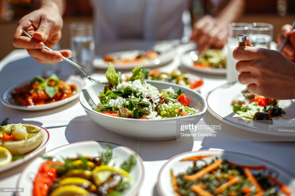 Couple  Eating Lunch with Fresh Salad and Appetizers : Stock Photo